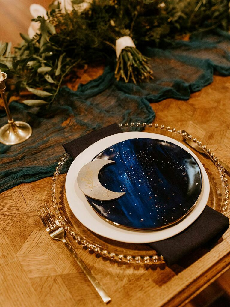Astrology-inspired place setting with moon place card and navy and gold accents