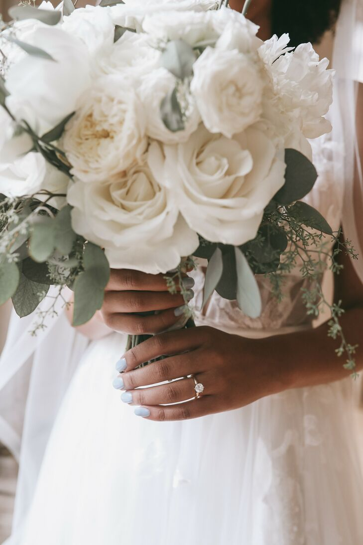 Up-Close Shot of Bouquet With White Roses and Eucalyptus