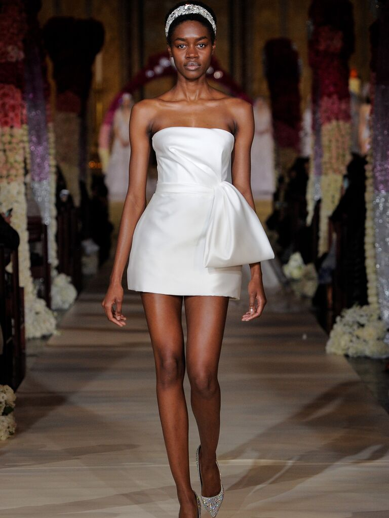 Reem Acra Spring 2020 Bridal Collection strapless short asymmetrical wedding dress with oversize bow detail