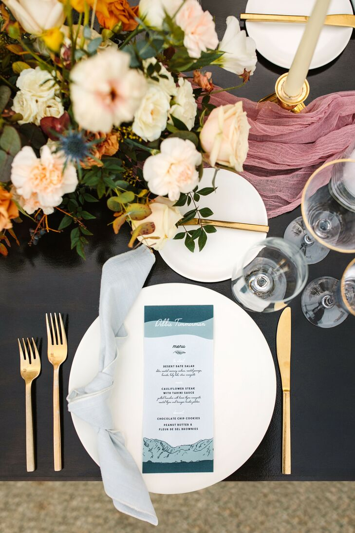 Place Setting With Mauve Table Runner, Gold Flatware and Blue Menu Card