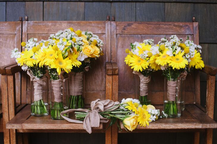 Renee's bouquet included a blend of yellow roses, craspedia, white freesia and aster tied with burlap ribbon. The bridesmaids bouquets added yellow daisies.