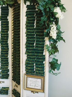 Green and Gold Escort Cards Displayed in Vintage Shutters