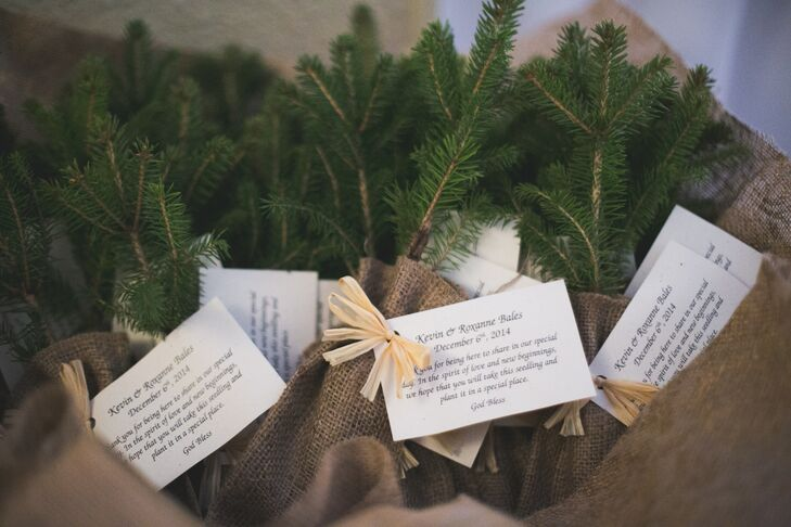 """The couple gave each guest a fir tree sapling wrapped in burlap with their wedding date, a special poem and planting instructions. """"We thought this would be a good idea because it was a Christmas time wedding and people would have this tree forever,"""" says Roxanne."""