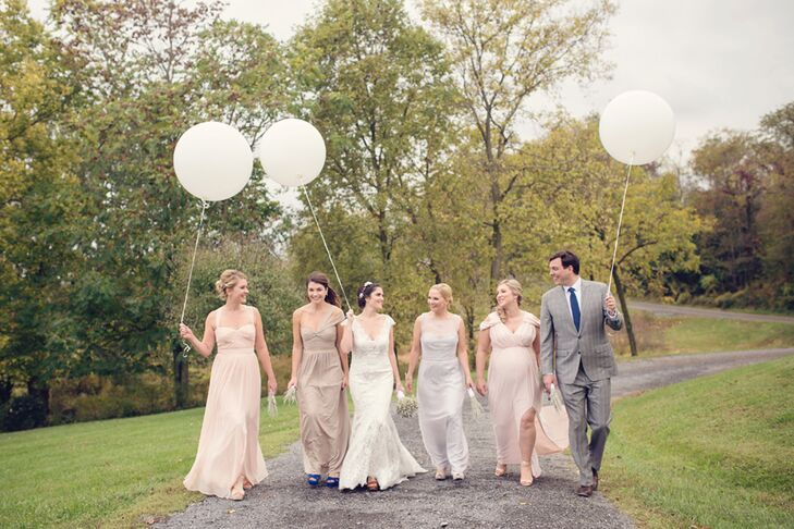 """Once Erin gave her bridesmaids and bridesman a gold, neutral, blush, pale blue and mint color palette, they were free to pick any outfit of their choosing. Each woman chose a long, light-colored gown with a sweetheart neckline. Erin's brother had something a little extra special in mind. """"My brother wore the same suit he wore to his own wedding just four months earlier,"""" she says."""