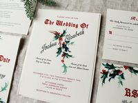 Old-fashioned design with red type and mistletoe graphic