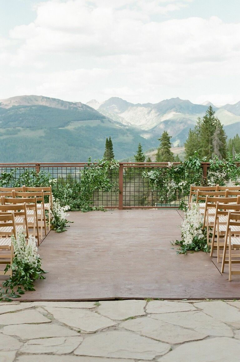 Terrace wedding ceremony with mountain views
