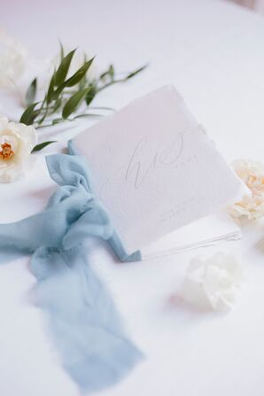 Elegant White Torn-Edge Vow Booklet Tied with Blue Ribbon