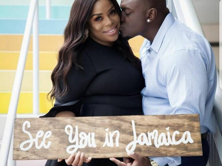 'See you in Jamaica' in loopy white script on stained wooden sign