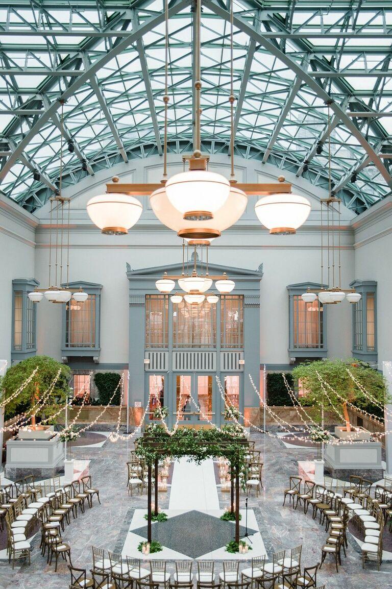 Mandap under twinkle lights in atrium wedding venue