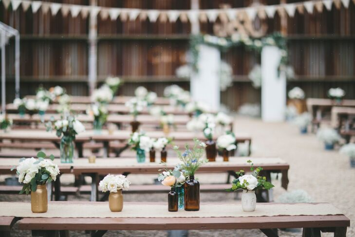 The transition to the reception was effortless with both parts of the evening taking place in TBD Brooklyn's outdoor beer garden. Wooden picnic tables dressed with burlap runners and vintage medicine bottles filled with fresh white flowers set a laid-back tone for the evening, while strings of bistro lights added warmth and ambiance to the intimate space.