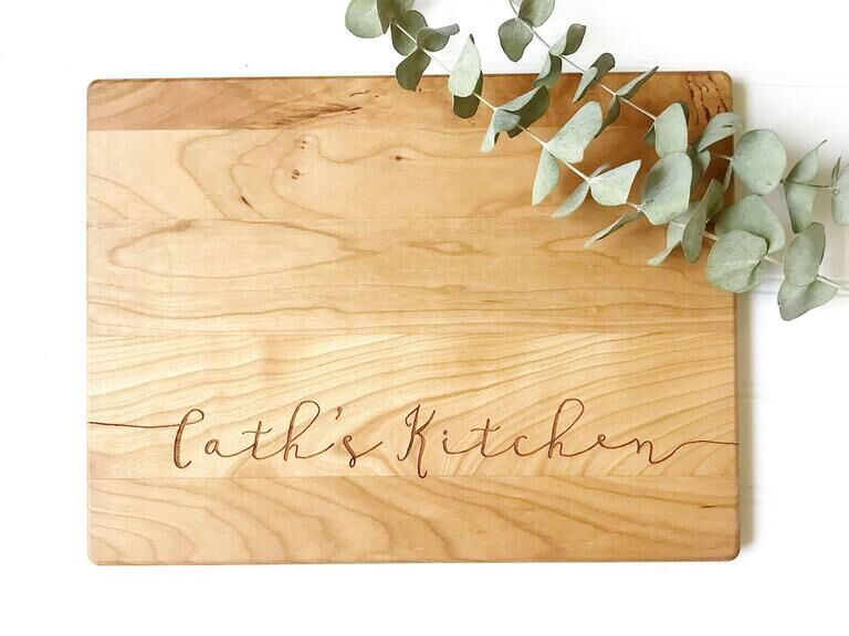 Wooden serving board engraved with Cath's Kitchen