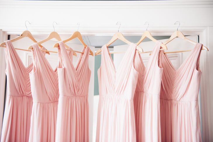Bridesmaids wore long, floor-length blush dresses in V-neck styles for a flowing, romantic look throughout the ceremony and reception.