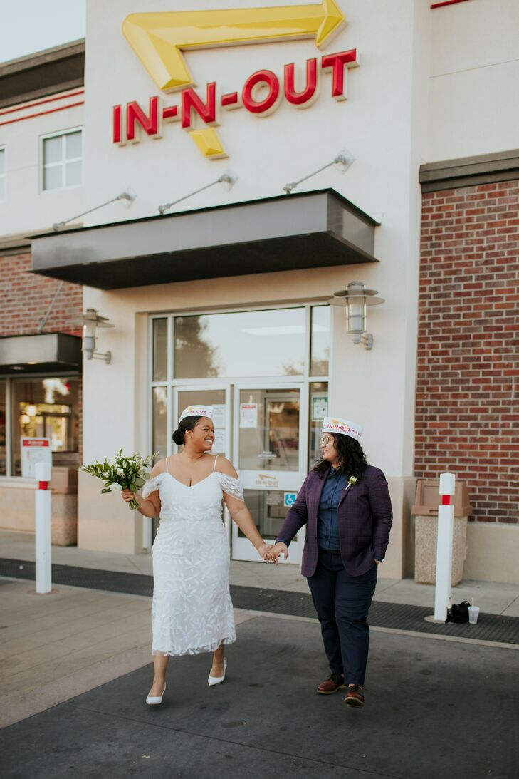 Couple Holding Hands and Walking Near In-N-Out Burger