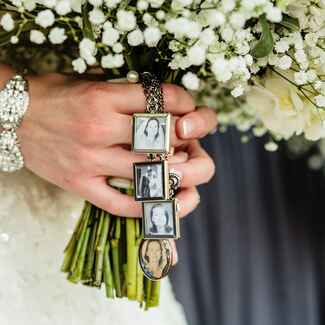 Bouquet with photos of deceased loved ones