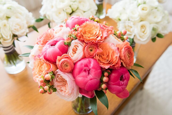 """Julia's bouquet was an explosion of color with pink peonies, coral ranunculus, blush garden roses, orange hypericum and peach roses. Barbara Bell Design tied it all together with a white ribbon. """"My bouquet was perfect!"""" says Julia."""