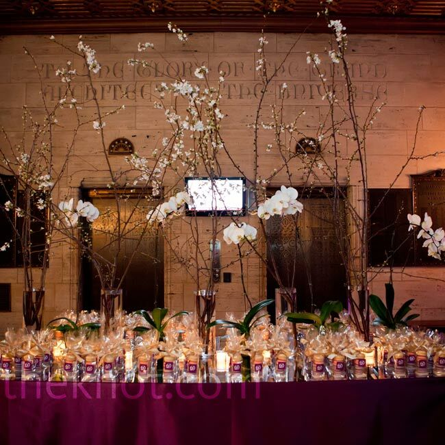 Orchid stems and long cherry blossom branches topped the favor table.