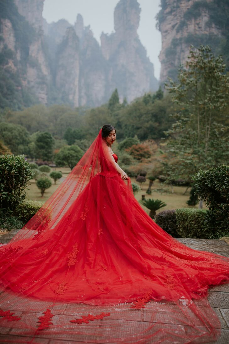 Bride With Dramatic Red Dress and Red Veil in Zhangjiajie, China