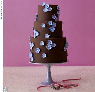 Chocolate wedding cake with purple flowers