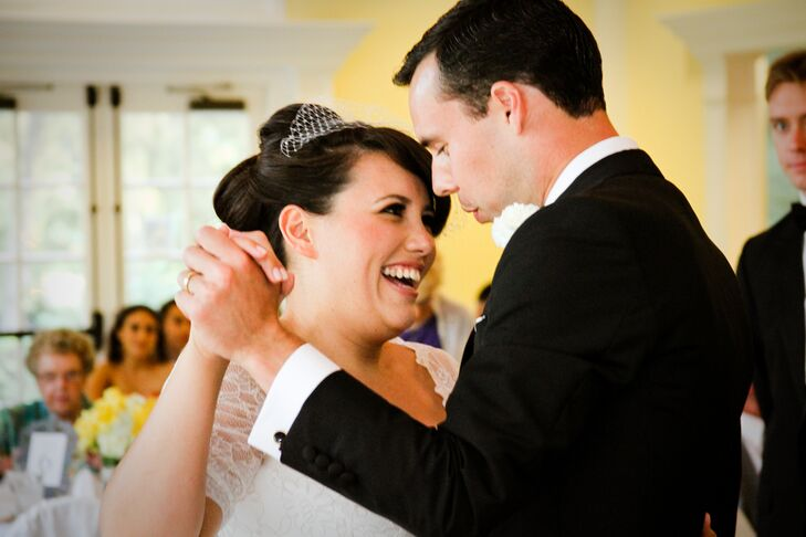 Brandy had her hair styled into an updo and wore an ivory vintage birdcage veil. In this shot, the couple had their first dance as husband and wife to a song by Sam Cooke in front of loved ones at the reception. Brandy and John shared a love for classic songs, so they had their DJ playing oldies all night.