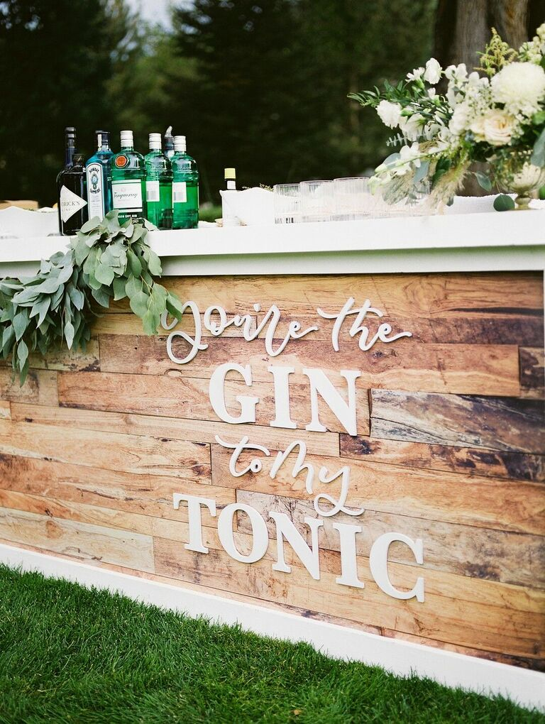 Custom wood bar front with calligraphy