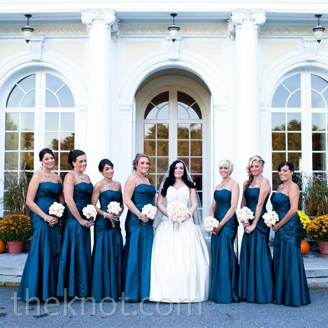 All seven bridesmaids wore similar silhouettes to Justine's dress in a romantic deep-blue tone.