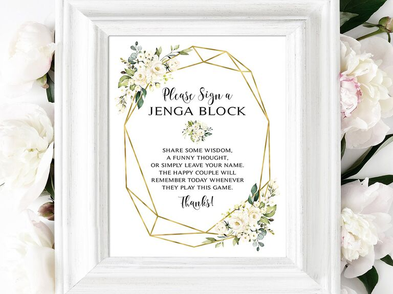 'Please sign in' in black script in gold geometric border with white flowers in white frame