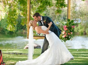 """""""Our theme was summertime romance and watercolor—we had bright pinks and cream colors throughout our wedding,"""" says Lindsay Baker (26 and an optometri"""