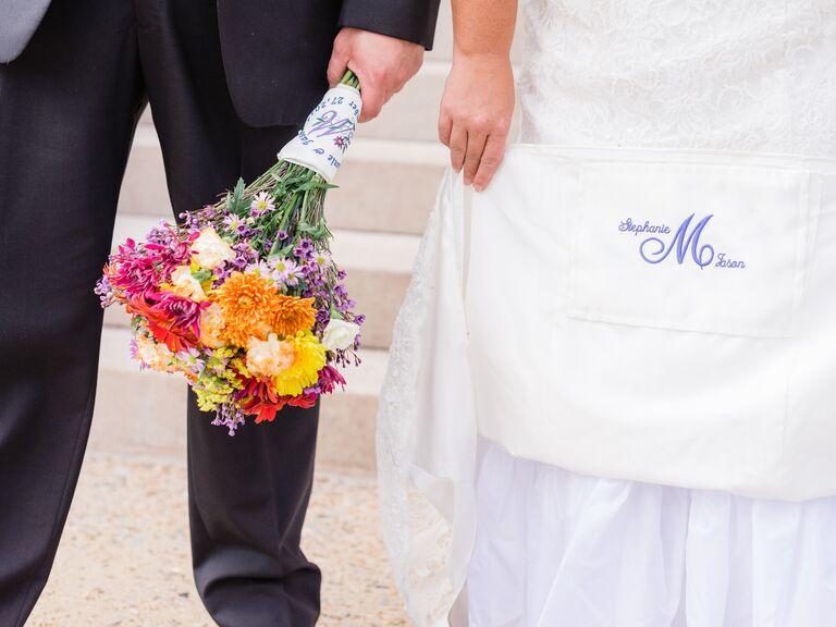 Bride with monogrammed wedding dress
