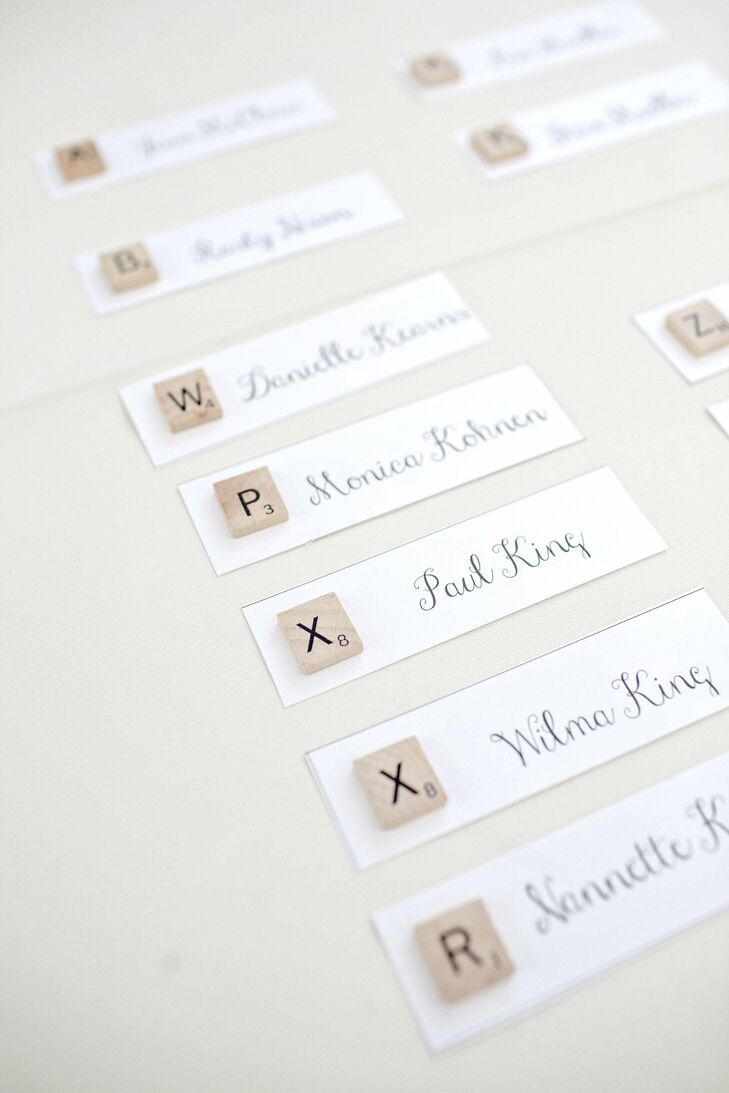 The couple included their board game proposal in the wedding with simple Scrabble escort cards.