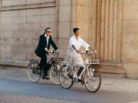 Couple riding bikes outside