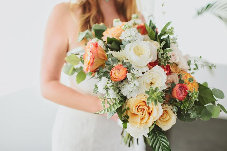 """""""I wanted a boho beach wedding with rich orange sunset colors in the flowers,"""" says Gwynne, whose florist, The Little Branch, created a fiery peach and ivory bouquet from garden roses."""