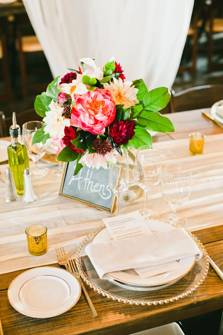 Travel-inspired details made an appearance throughout the wedding day, such as this table sign named after a location where Lydia and Brandon had visited together.