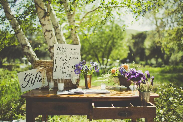 """""""I wanted clean vintage items mixed with more modern pieces to keep our wedding from looking too rustic,"""" Lindsey says of her wedding decor."""