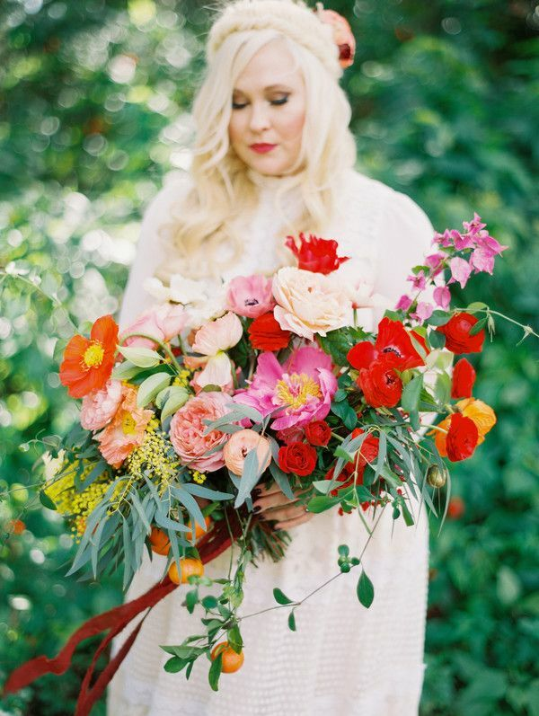 bride holding pink-and-red wedding bouquet