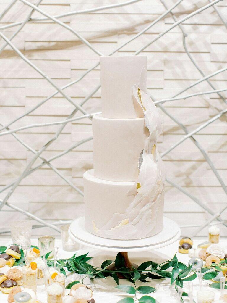 Modern three-tier wedding cake with ruffles