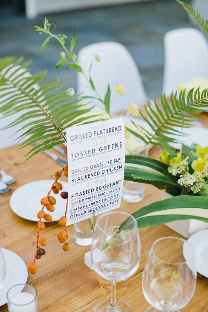 The night's menu was printed in modern typography and displayed amid the centerpieces on the long tables.