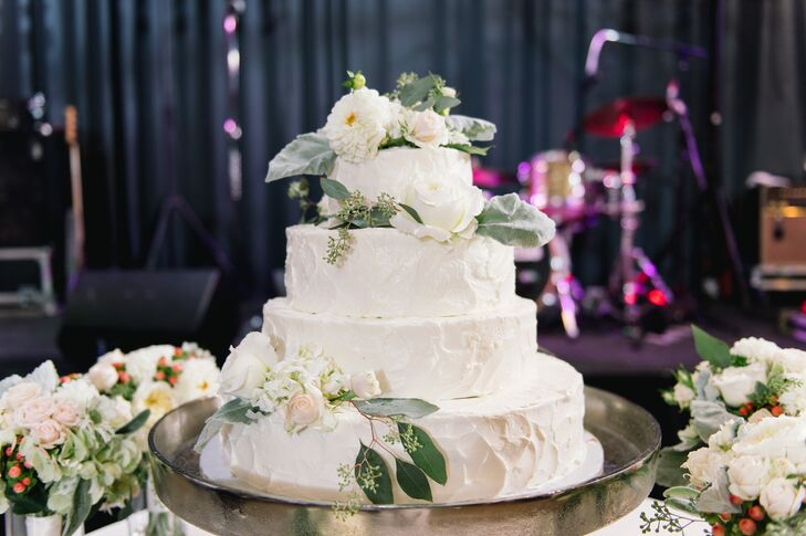 Each layer of the four-tiered buttercream cake offered a different flavor including coconut cake with strawberry filling and chocolate with chocolate ganache.