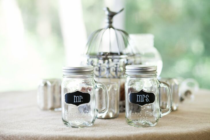 The couple toasted to their nuptials with matching Mr. & Mrs. mason jar glasses.