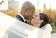 Sydney and Todd, who first met at a wedding themselves, tied the knot with an intimate, family-only wedding at the Cancer Survivors' Garden in Chicago