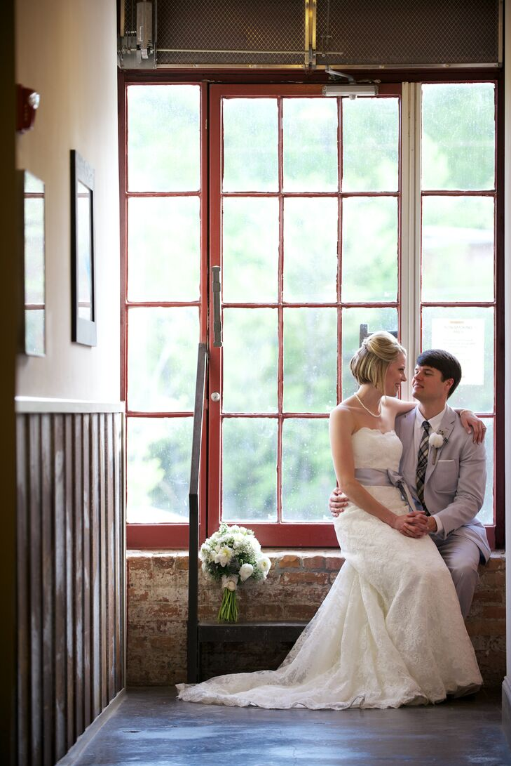 Sticking with the Southern, rustic look, Tara decided to go with a lace wedding gown. She found the perfect dress at Formally Yours in Lilburn, GA by Mori Lee. The strapless dress had a scalloped edge that she had custom-made into a sweetheart neckline.