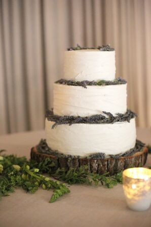 Tiered Buttercream Wedding Cake on Wooden Stand