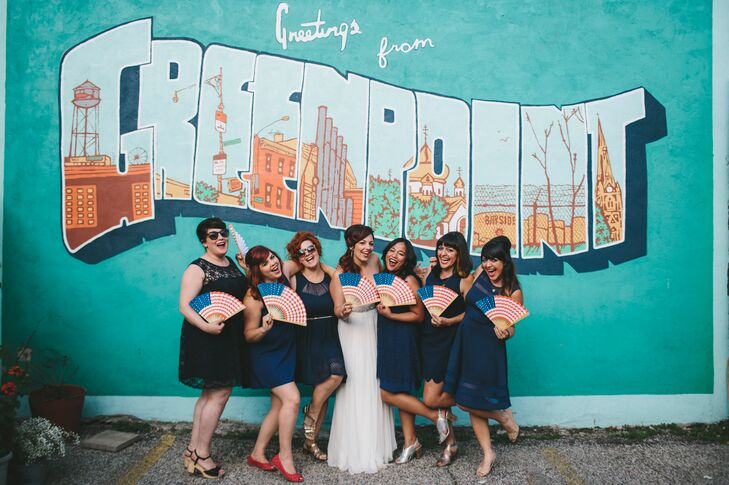 """Jen's six bridesmaids wore short navy dresses of their choosing from Modcloth, Forever21 and Gather & Gown with metallic shoes and their own jewelry. """"I wanted them to look comfortable and not overdressed for the wedding's casual vibe,"""" says Jen. """"Fun sunglasses were encouraged."""""""