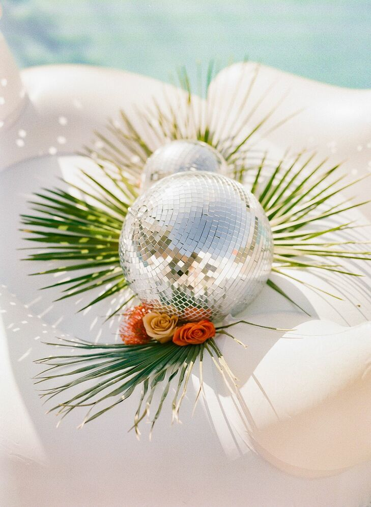 Disco Ball Décor in Pool at Palm Springs Wedding
