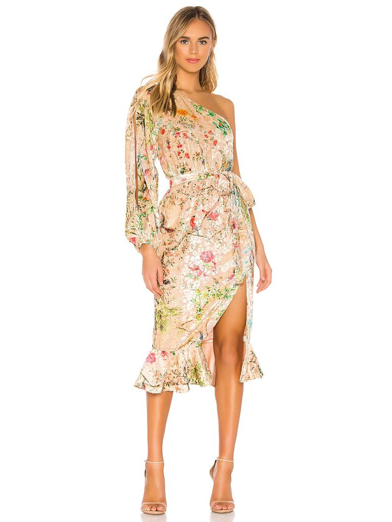 revolve cream velvet wedding guest one shoulder cocktail dress with long sleeve tie waist slit multicolored floral print and ruffle trimmed skirt