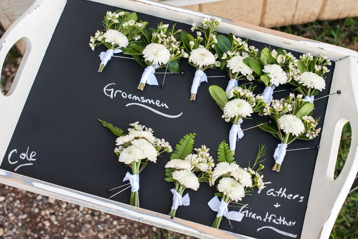 Cole and his groomsmen wore matching boutonnieres with ivory mums and small ferns.