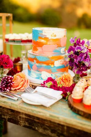 The Tiered Cake Featured Orange, Pink, White and Blue Icing