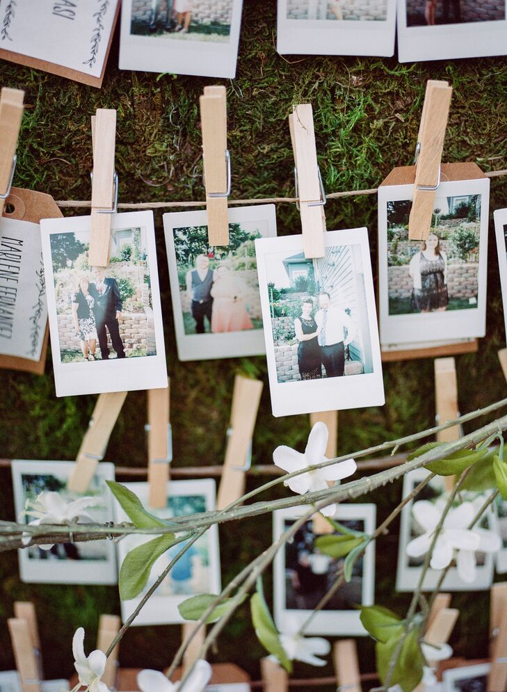 """When guests found their escort card, they had their photo taken with a Polaroid camera, then replaced their escort card with their photo. """"It was a great way to get photos of everyone who attended,"""" Shelby says."""