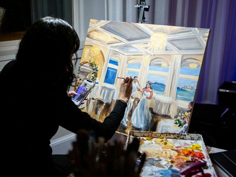 Live wedding painter at wedding reception