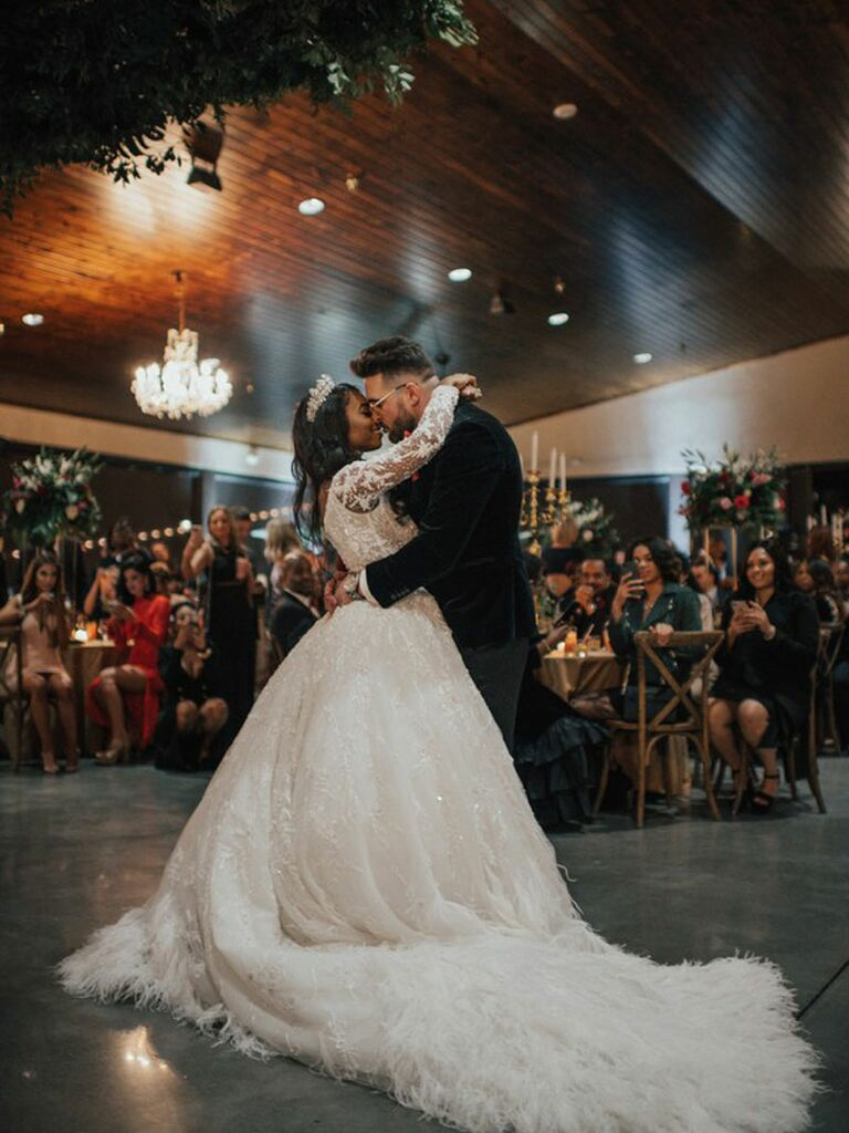 Bride and groom dancing during first dance at wedding reception