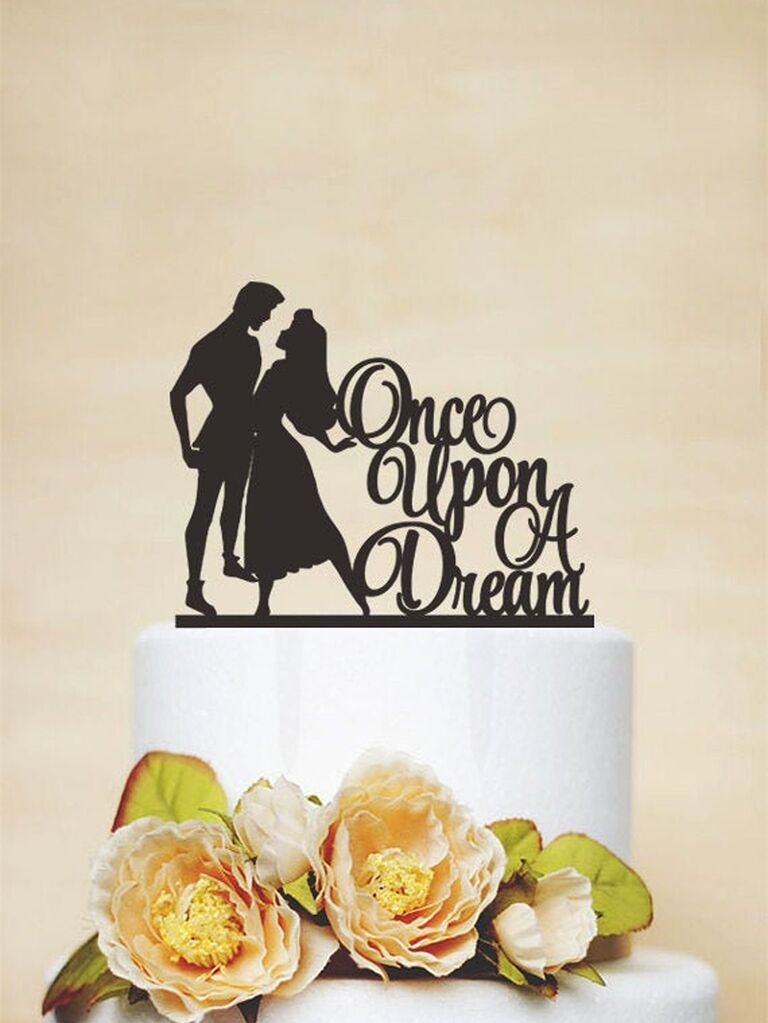 Black acrylic topper with Sleeping Beauty and prince silhouettes and 'Once upon a dream' in elegant script